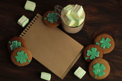 Decorative cookies on wooden background. Saint Patricks Day concept Royalty Free Stock Image