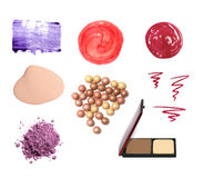 Decorative cosmetic samples. Isolated on white. Lipstick, lip gloss, eyeshadow, pencil and mascara strokes, powder, foundation spilling Stock Image