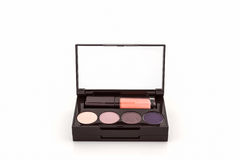 Decorative Cosmetic set with lipstick and eyeshadow. Royalty Free Stock Photography