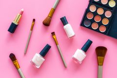 Decorative cosmetic set for natural makeup on pink background top view Royalty Free Stock Images