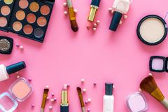 Decorative cosmetic set for natural makeup on pink background top view copyspace Stock Photo