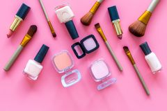 Decorative cosmetic set for natural makeup on pink background top view Royalty Free Stock Photo