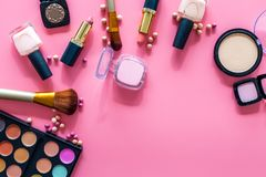 Decorative cosmetic set for natural makeup on pink background top view copyspace Royalty Free Stock Image
