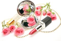 Decorative Cosmetics And Roses Royalty Free Stock Images