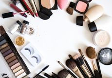 Decorative cosmetics for make up. Nude eyeshadows, brushes and skin tone on white background top view. stock photo