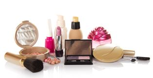 Decorative cosmetics, bottle of perfume and nail Stock Photography
