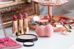 Decorative cosmetics on dressing table. In makeup room royalty free stock photos