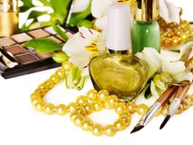 Decorative cosmetics and flower. Royalty Free Stock Photos