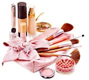 Decorative cosmetics and flower. Royalty Free Stock Photo