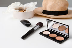 Decorative cosmetics hat and chocolate over white background. Royalty Free Stock Photo
