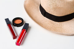 Decorative cosmetics and hat over white background. Royalty Free Stock Images