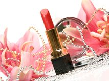 Decorative cosmetics and lilies Royalty Free Stock Images