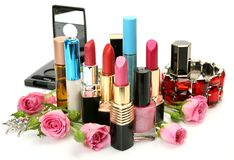 Decorative cosmetics and roses Stock Images