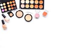 Decorative cosmetics set, Eyeshadows, rouge, nailpolish on white background top view copyspace Royalty Free Stock Images