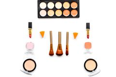Decorative cosmetics pattern. Eyeshadows, rouge, brushes on white background top view Stock Photography
