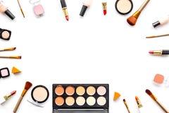 Decorative cosmetics pattern. Eyeshadows, rouge, nailpolish, brushes. lipstick on white background top view copyspace Royalty Free Stock Photo