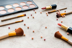 Decorative cosmetics on stone background Royalty Free Stock Photos