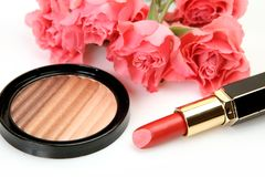 Decorative cosmetics and pink flowers stock photo