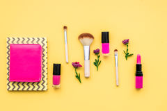 Decorative cosmetics on yellow background top view Royalty Free Stock Photography