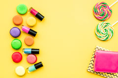 Decorative cosmetics on yellow background top view.  Royalty Free Stock Image