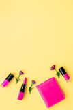 Decorative cosmetics on yellow background top view Stock Image