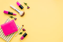 Decorative cosmetics on yellow background top view.  Stock Photography