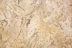 Decorative covering for walls under a light beige stone. Stock Photos