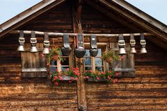 Decorative cow bells. Under the roof of mounain hut Royalty Free Stock Photo