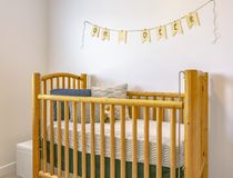 Decorative crib in model home stock images