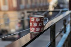 Decorative cup of coffee on the handrail, Naples, Italy. stock photos