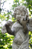 Decorative cupid playing violin sculpture Royalty Free Stock Photo