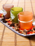 Decorative cups. Three colored  glasses for cocktails on the tray for party Stock Images
