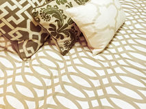 Decorative cushions on a bed Stock Images