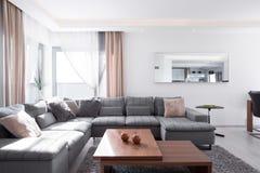Decorative cushions on corner sofa Stock Photos