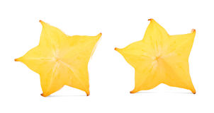 Decorative cut carambola fruit with a star-shaped cross section, isolated on a white background. Carambola for summer drinks. Stock Images