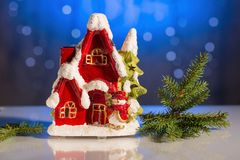 Decorative cute red house with christmas tree on blue sparkling background. Christmas / New year beautiful backgrounds.  royalty free stock photos
