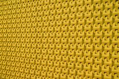 Decorative 3D pattern of the modern building outer wall in mustard yellow color. Texture background abstract architecture art backdrop banner bright closeup royalty free stock photos