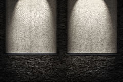 Decorative dark stone wall with lighter niches. light effect Royalty Free Stock Images