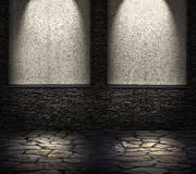 Decorative dark stone wall with lighter niches. light effect Stock Photos