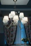 Decorative designer chandelier on a dark background Stock Image