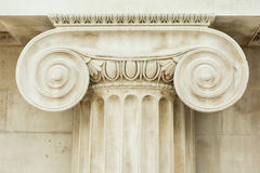 Decorative detail of an ancient Ionic column. Close up Royalty Free Stock Photography