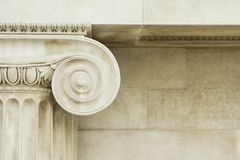 Decorative detail of an ancient Ionic column Stock Photo