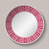 Decorative dish with red and white circular pattern. Empty Space for text in the center. Ornament in the style of ethnic porcelain Royalty Free Stock Photo