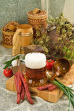 Decorative display. A decorative arrangement or display of wooden mugs and domestic items including dried herbs and garden vegetables stock images