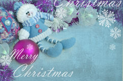 Decorative doll, Christmas tree decoration, toy on a blue background with snowflake. Greeting card Royalty Free Stock Image