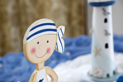 Decorative doll sailor smilling Royalty Free Stock Photo