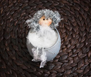 Decorative doll sitting in the ceramic bowl Royalty Free Stock Image
