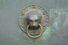 Decorative door knocker. Closeup of decorative metal door knocker with ring on Trier Cathedral, Germany Royalty Free Stock Image