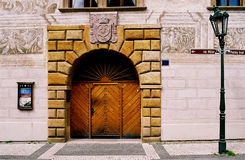 Decorative door and lamppost. Doorway made of wood and carved stone and bricks Stock Photography