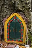 Decorative door in a tree Royalty Free Stock Photography